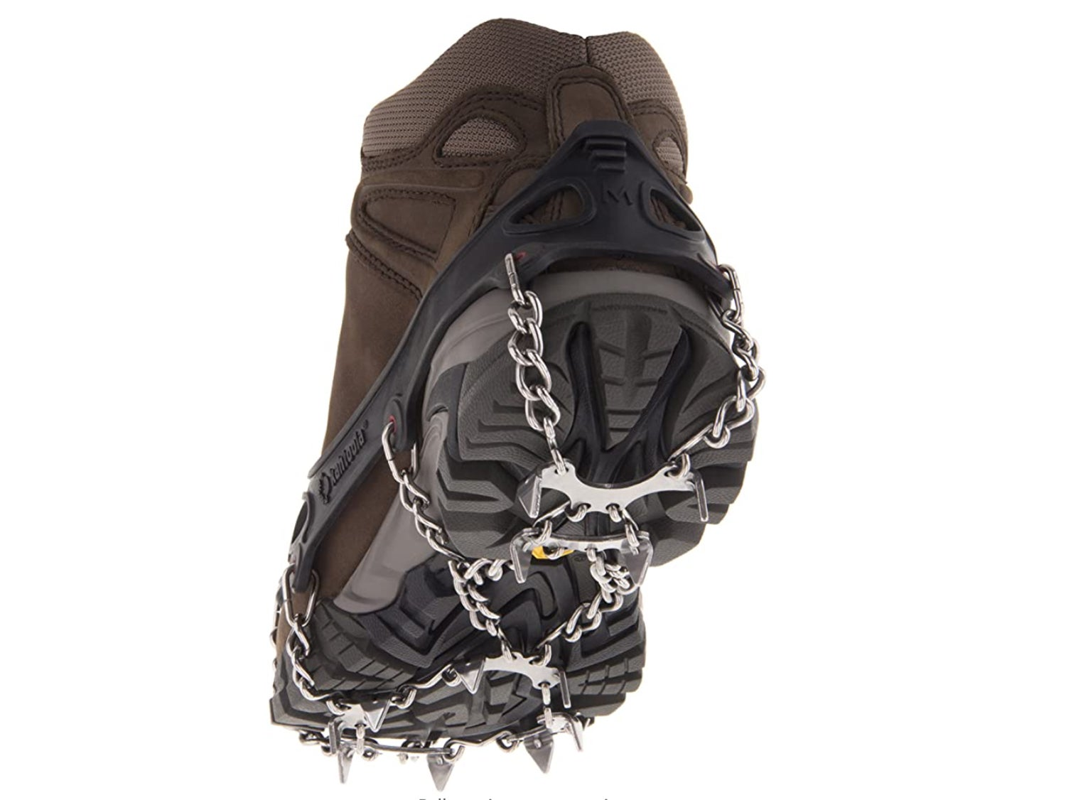 A boot equipped with spikes and chains for grip.