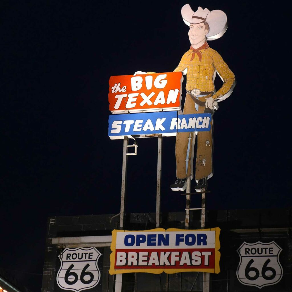 A Big Texan Steak Ranch sign outside a restaurant on Route 66