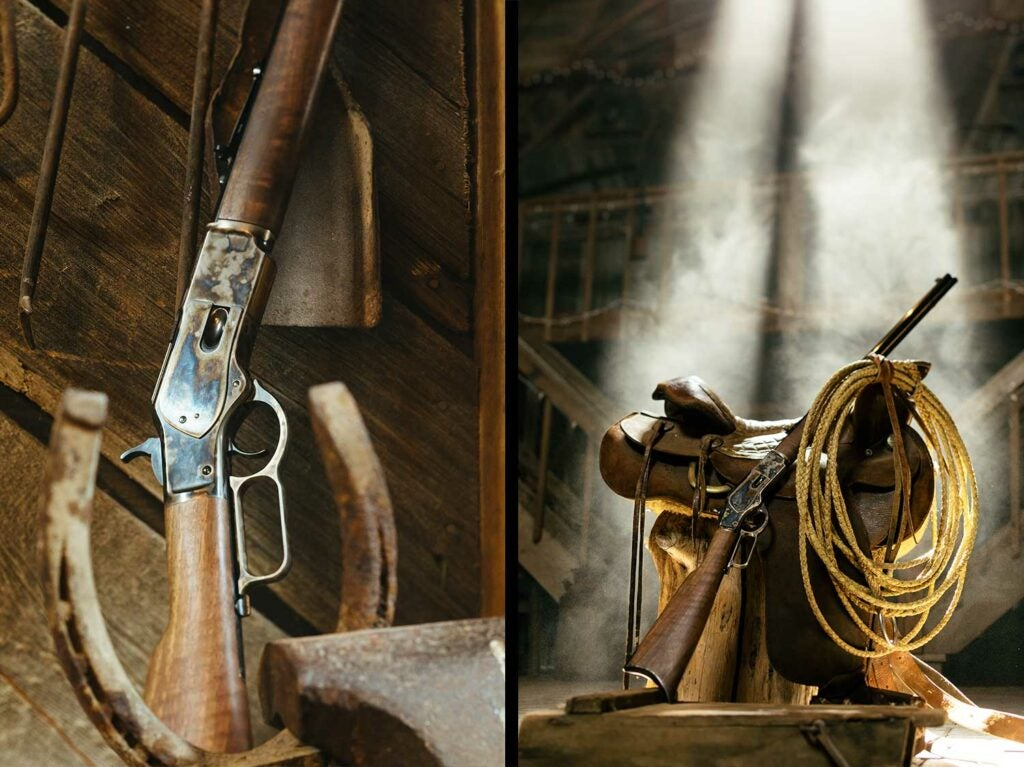 A Winchester rifle leaning against a leather saddle in a barn.