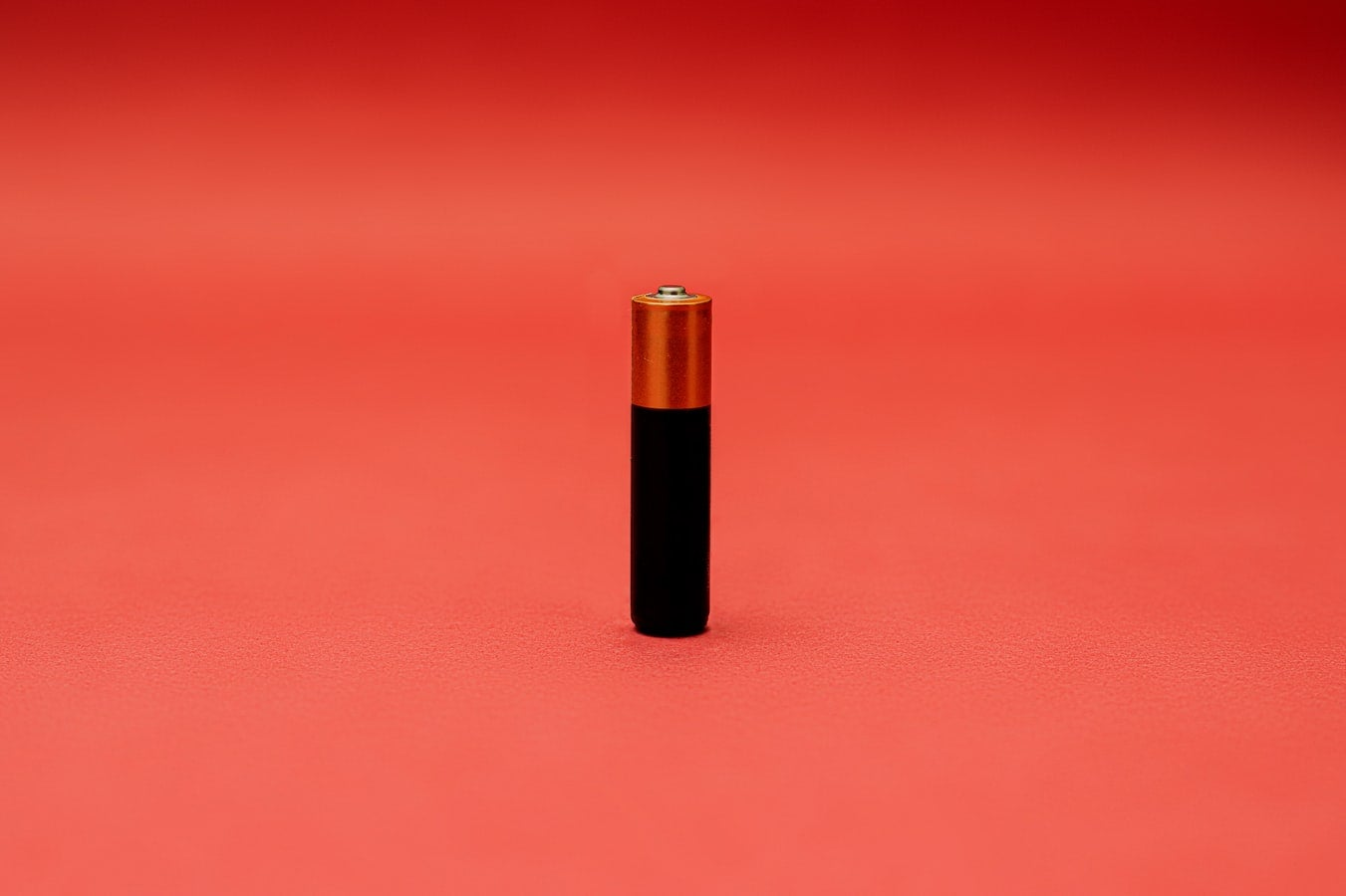 AAA battery on red background