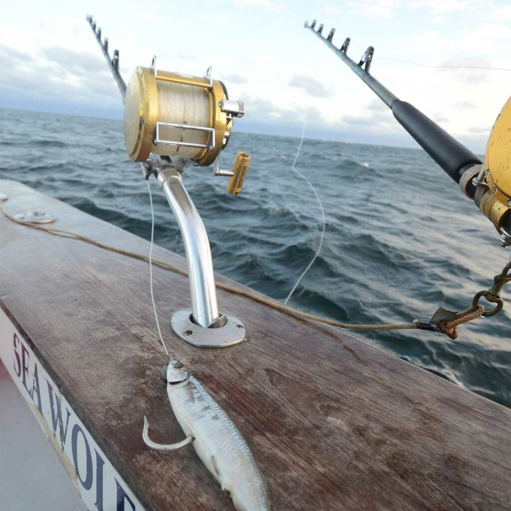 Two fishing reels on a boat deck.