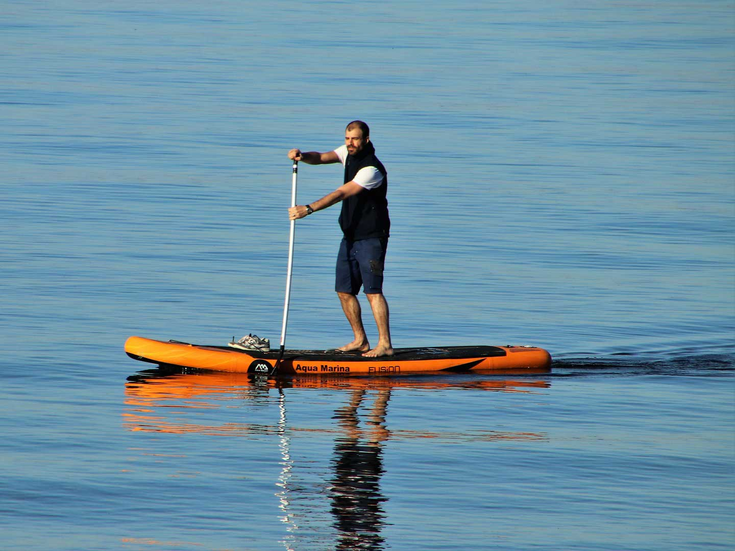 Man standing on inflatable watercraft