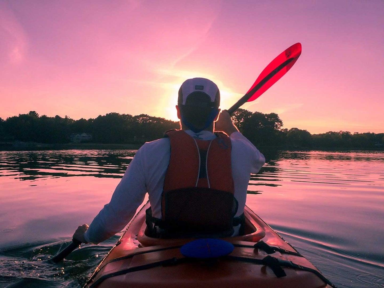 Paddling in kayak.
