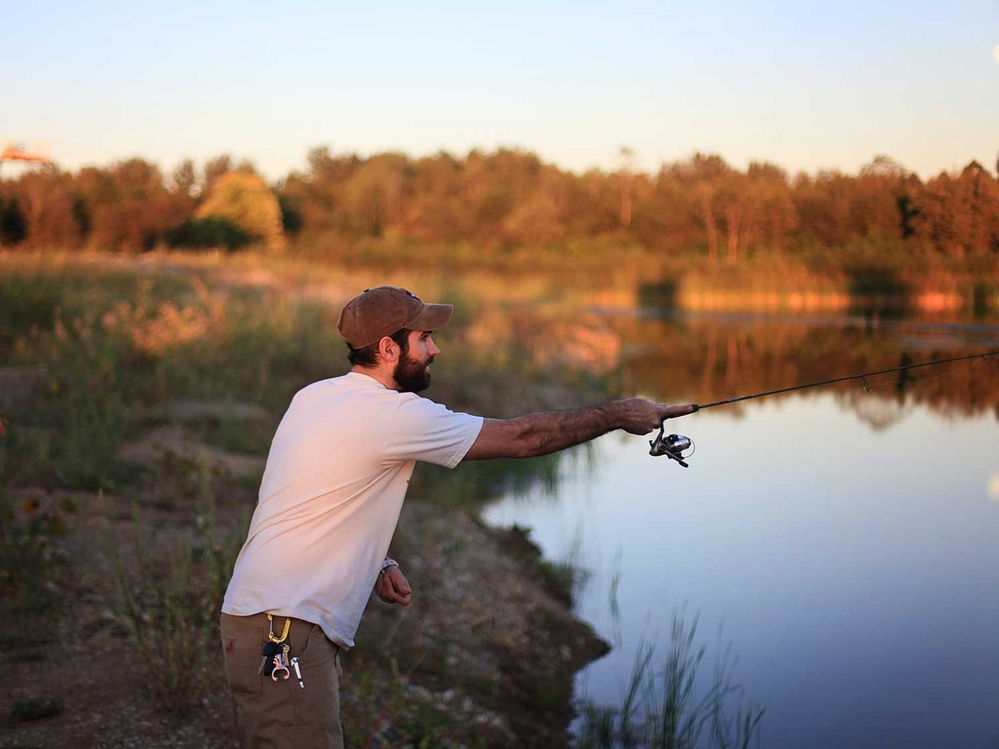 Man fishing with spinning reel.
