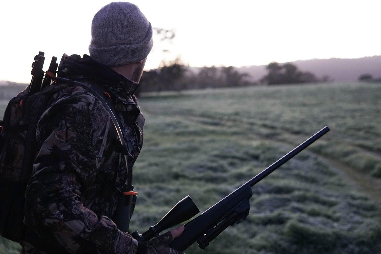Man wearing hunting hat