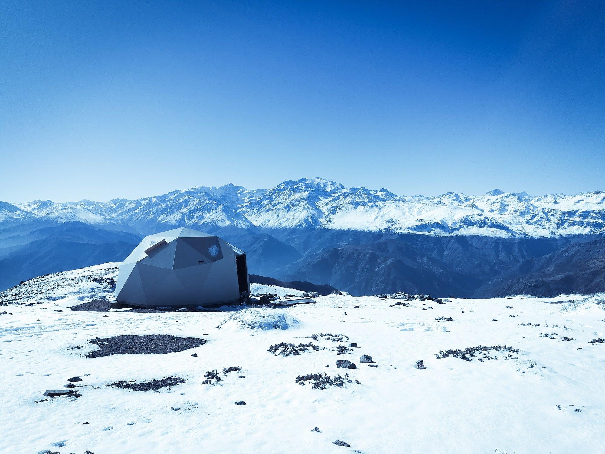 white tent on a snowy mountain
