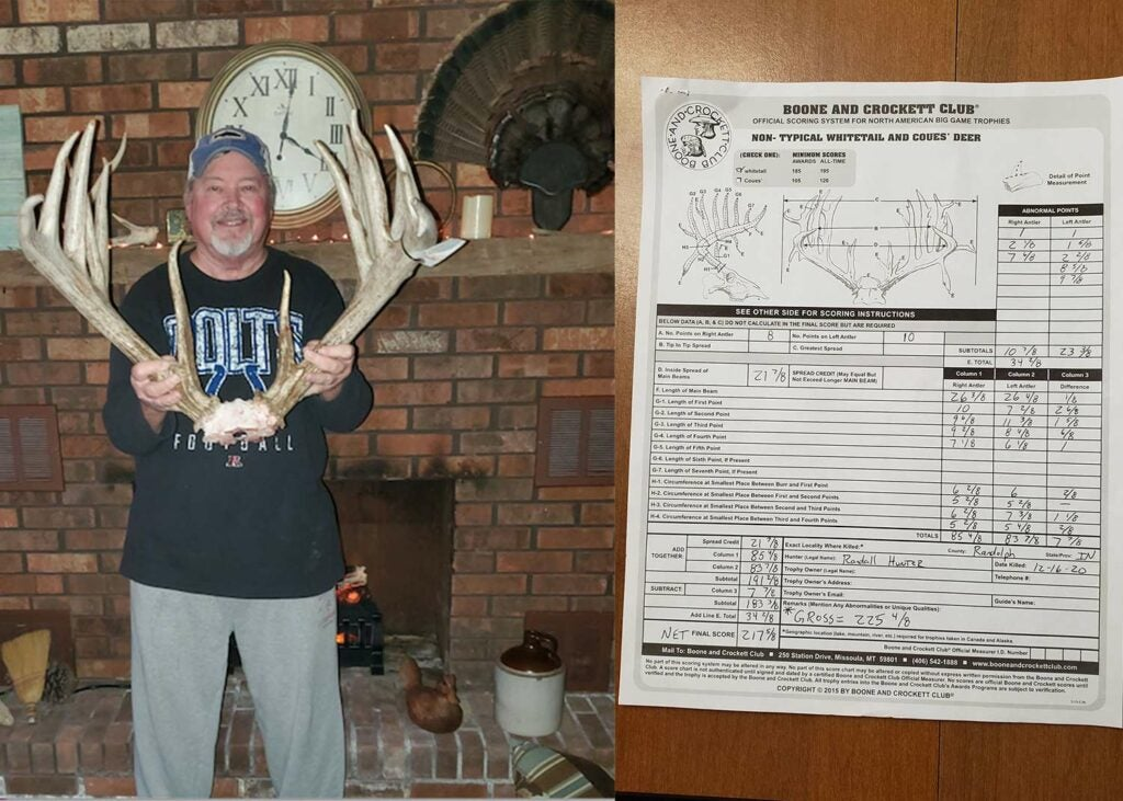A hunter holds up deer antlers next to a antler score sheet.