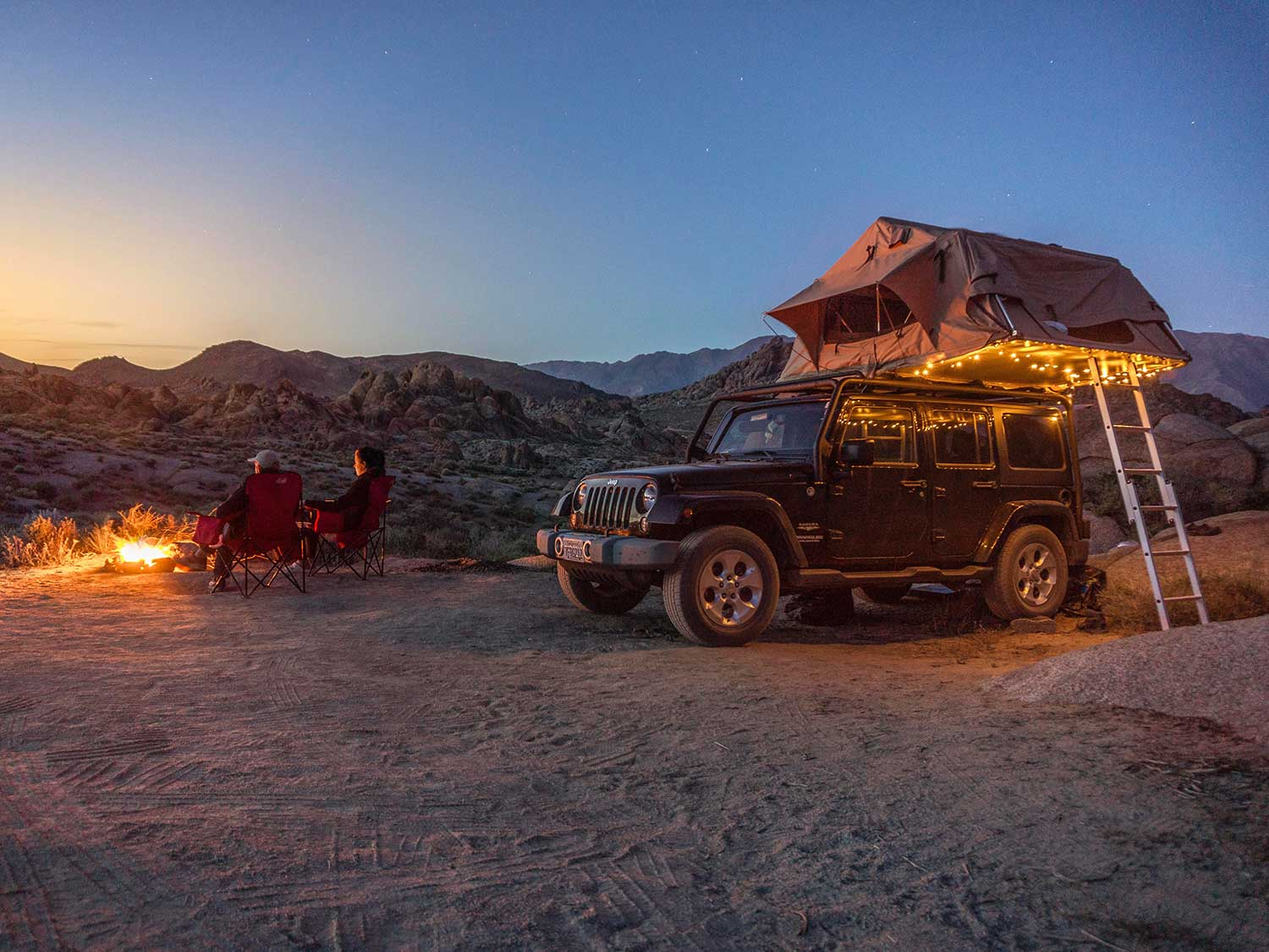 Truck tent on top of jeep.