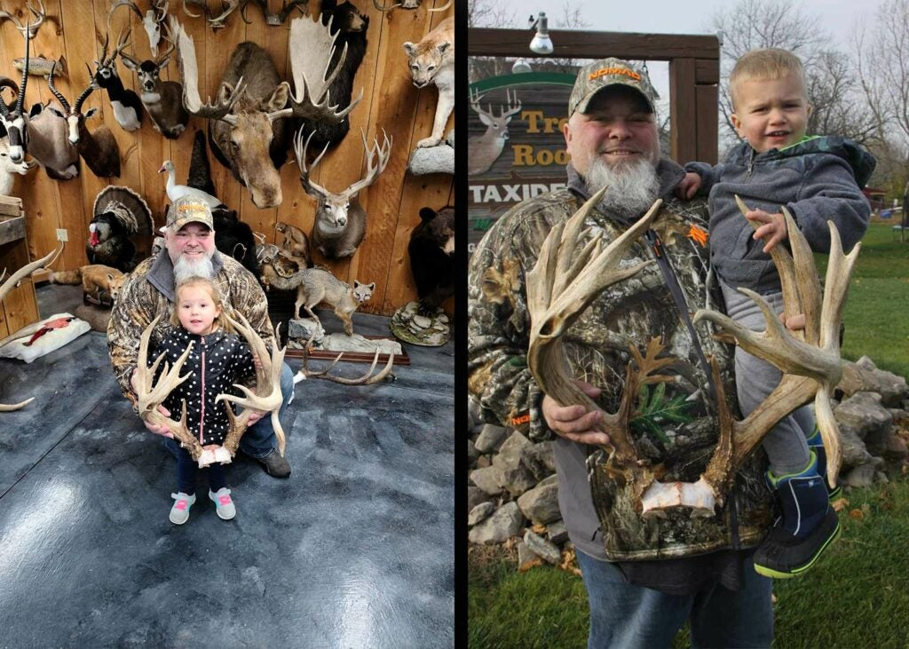 A hunter and his kid show off the deer antlers.