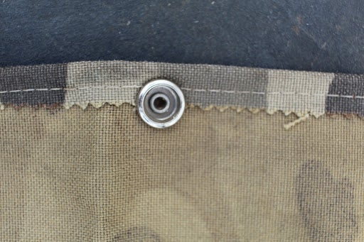 Button snap on fabric.