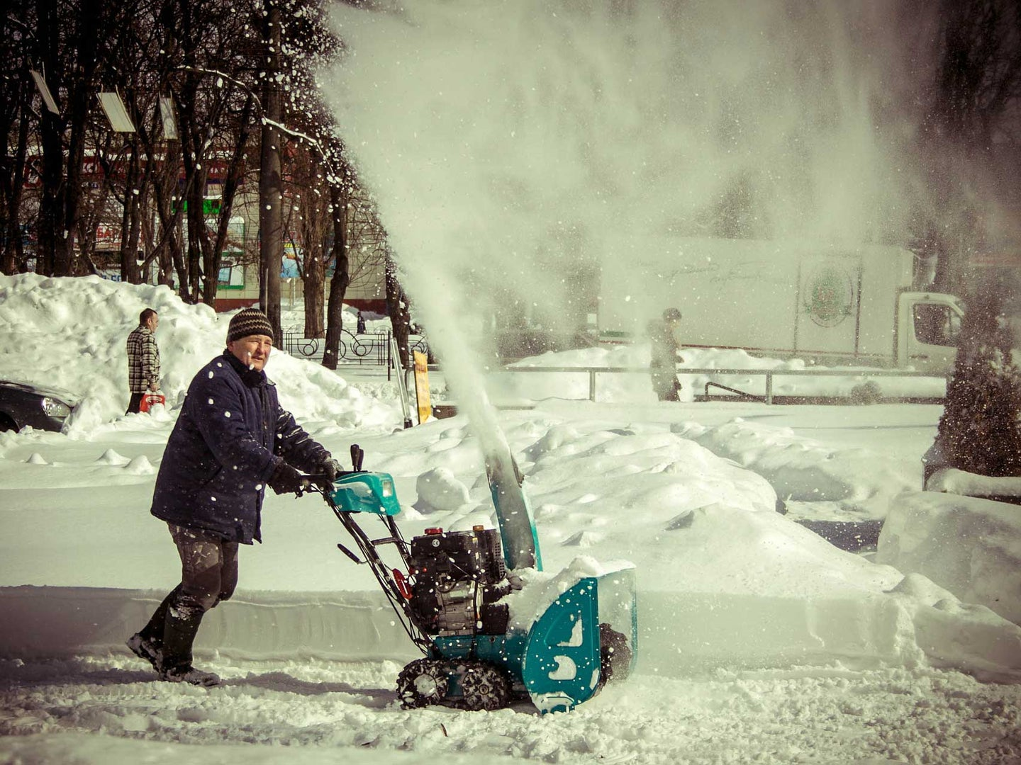Man clearing snow with the best snow blower