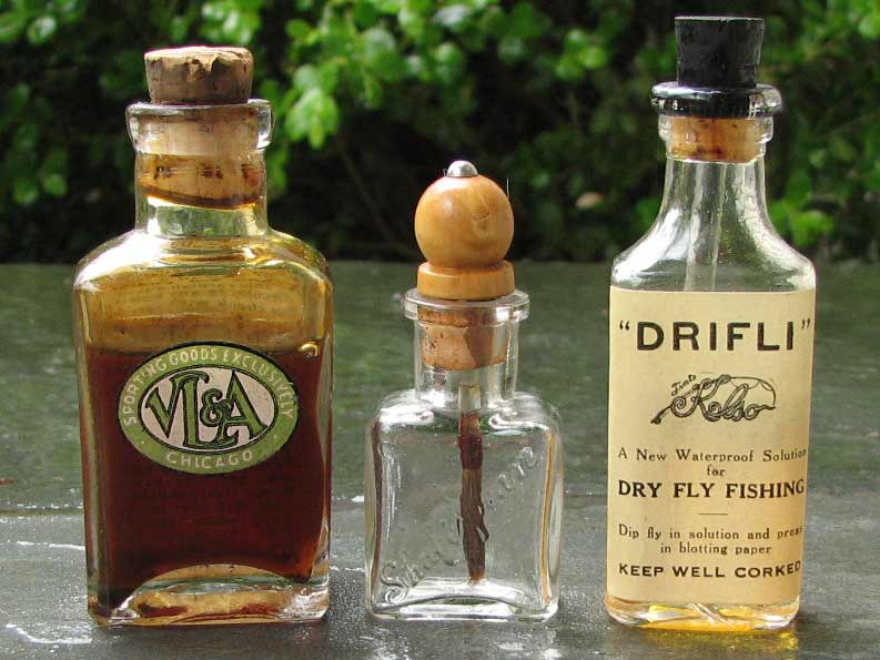 three bottles of fishing oil with cork bottle stoppers