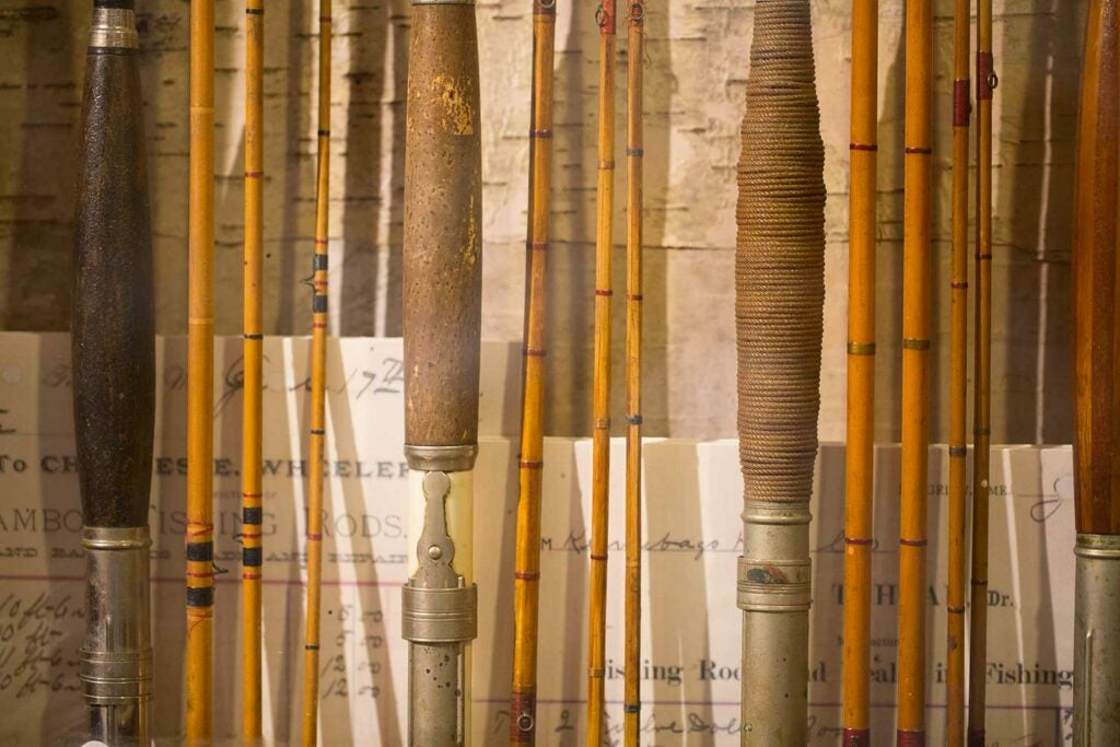 a group of antique bamboo fly rods