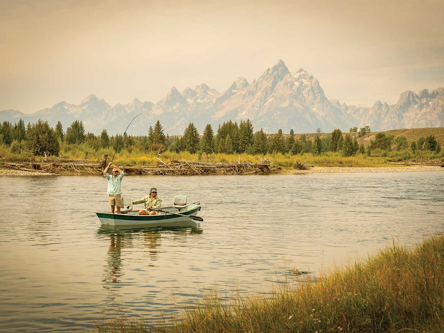 Two anglers in a boat at Grand Teton National Park.