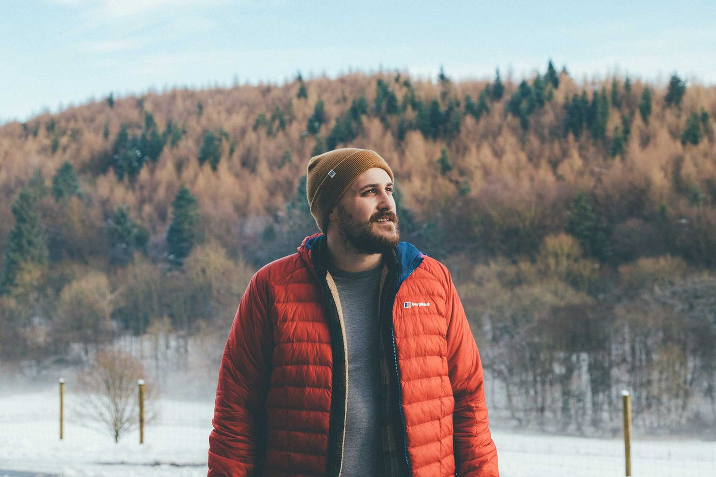 Man standing in the woods wearing some of the best winter clothing.