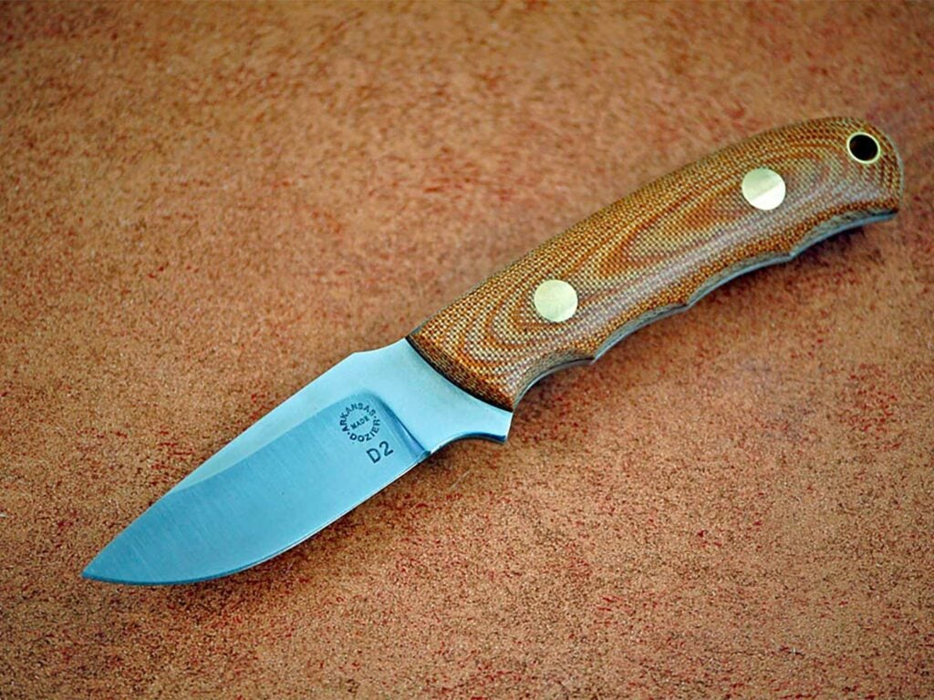 A knife on a brown background.