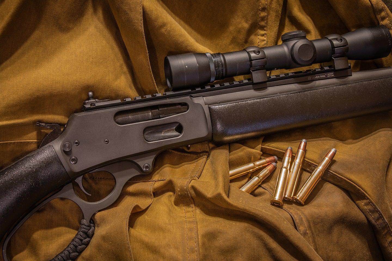 A Marlin 336 rifle on a burlap cloth.