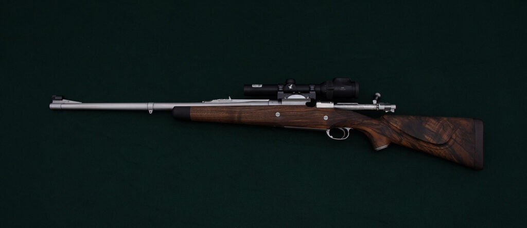 A Jeffrey Mauser Rifle on a green background.