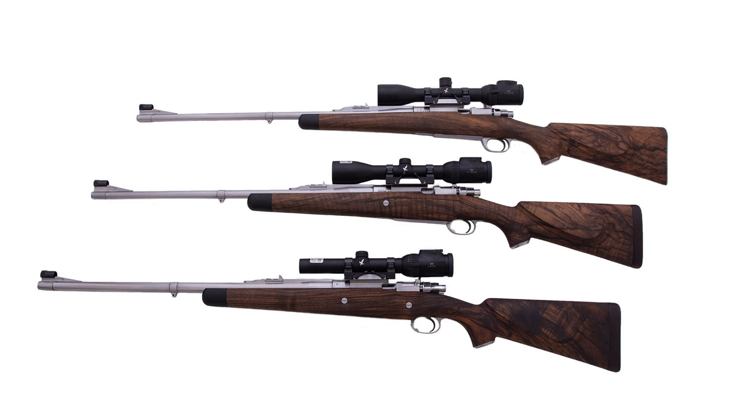Three rifles on a white background.