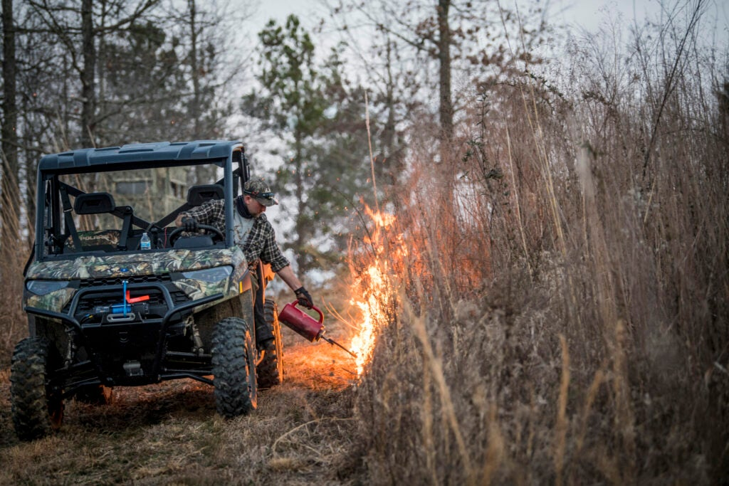 Turkey hunter performs a prescribed burn on public land.