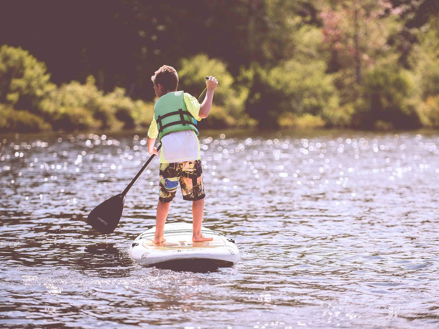 Young boy on a paddleboard