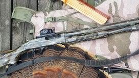 A Mossberg shotgun on a white background.