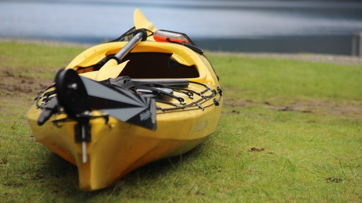 A paddle kayak outfitted with a rudder.
