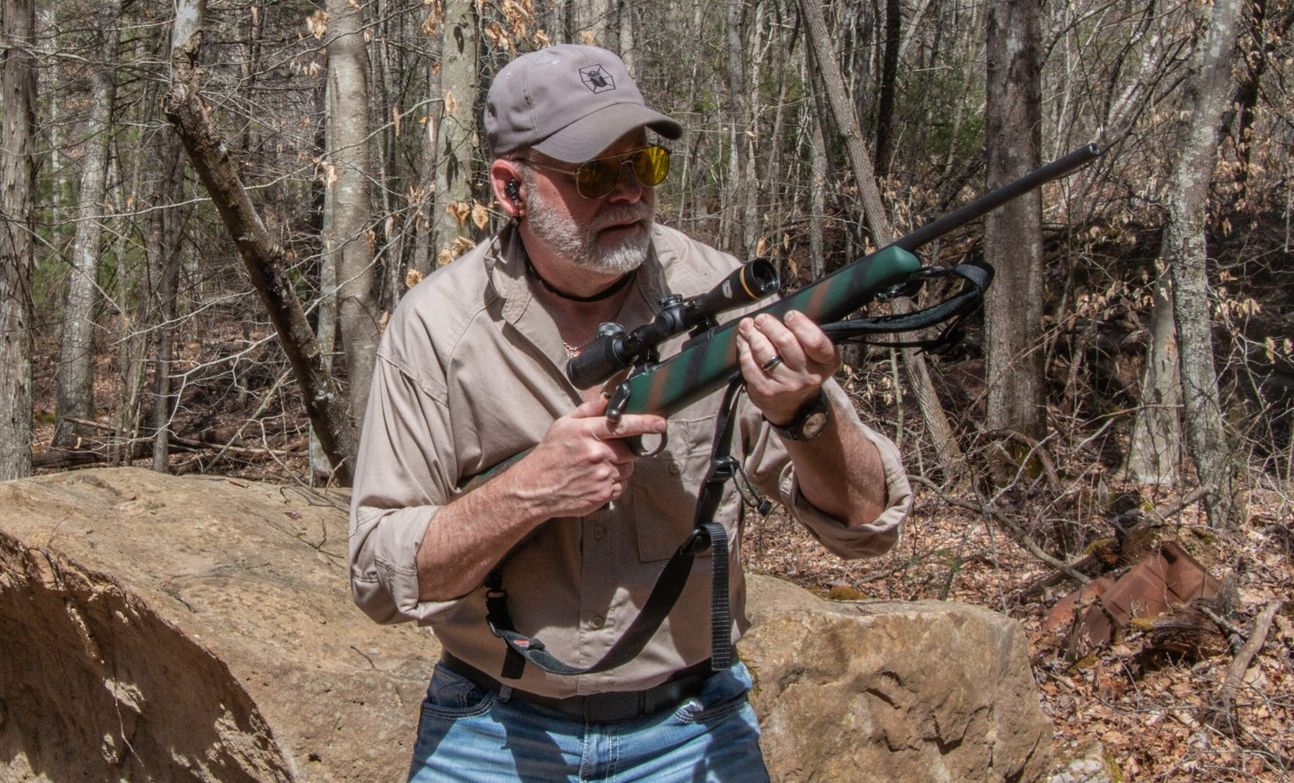 deer hunting rifle at high ready for shooting drill