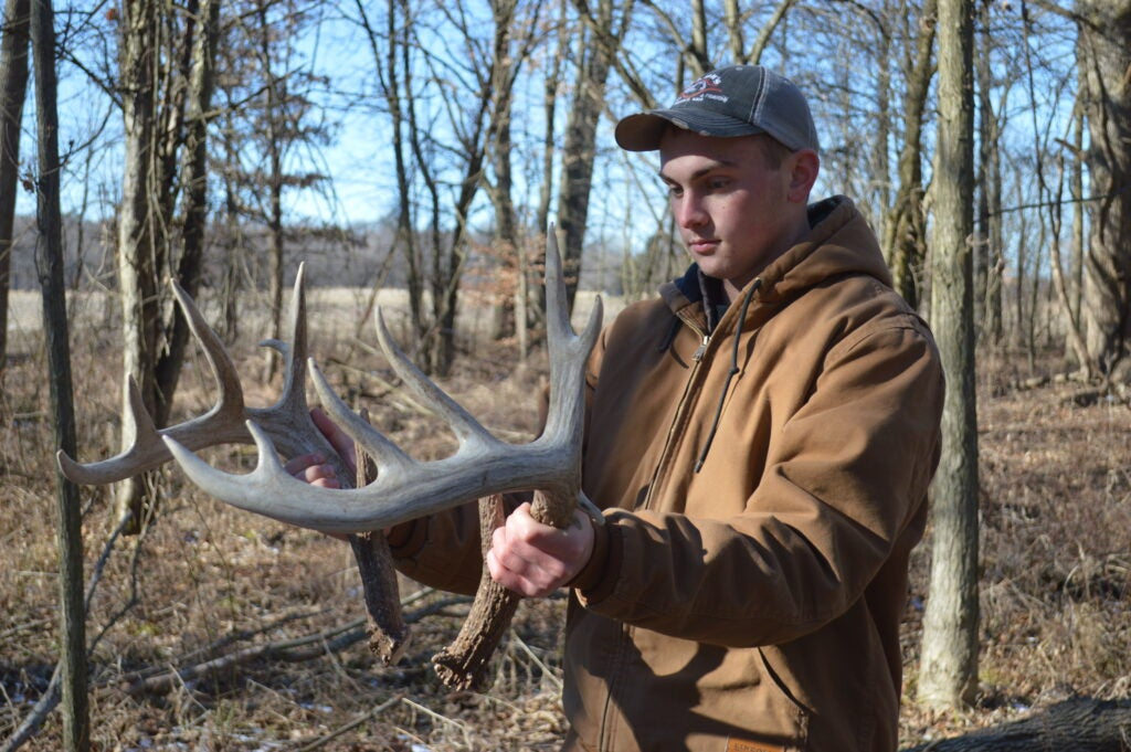 Mann with big matched 10-poin shed antlers