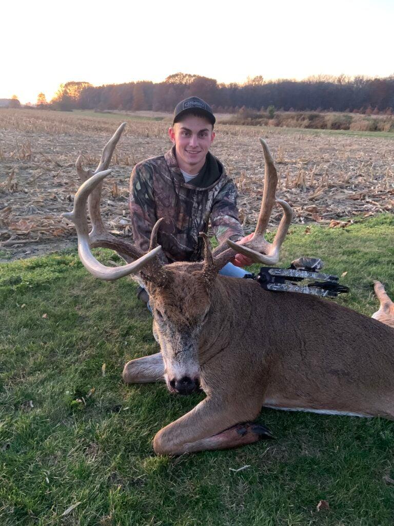 Brandon Mann and 170-inch whitetail buck.