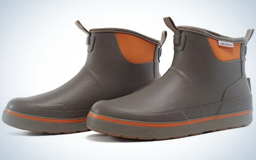 A pair of boots from the sides with two colors brown and orange.