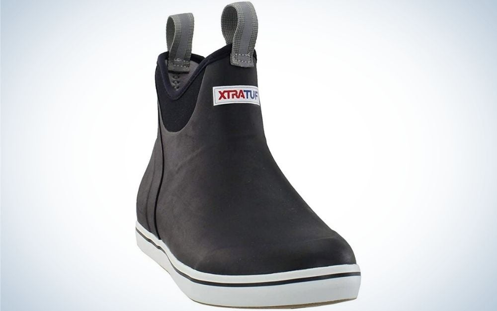 A black Xtratuf boot with white tire under it.