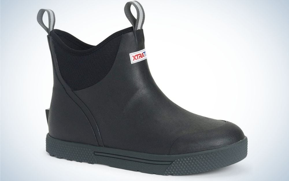 A full black boot with the name of brand in front of it.