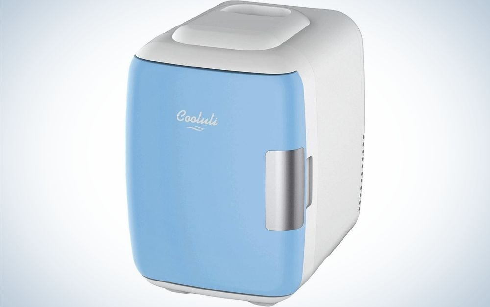 A white and light blue bow Cooluli mini fridge electric cooler and warmer.