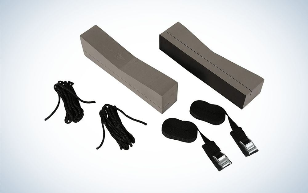 Kayak roof rack including supporting foam blocks, two straps with adjusting buckles, and clips