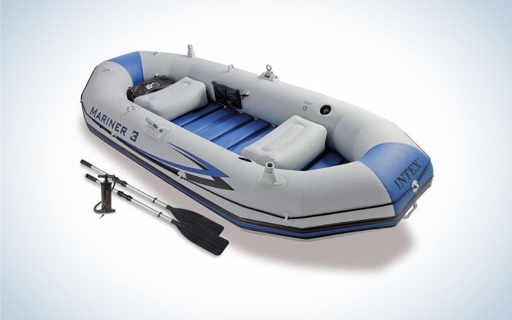 Blue and light gray inflatable boat with black paddles