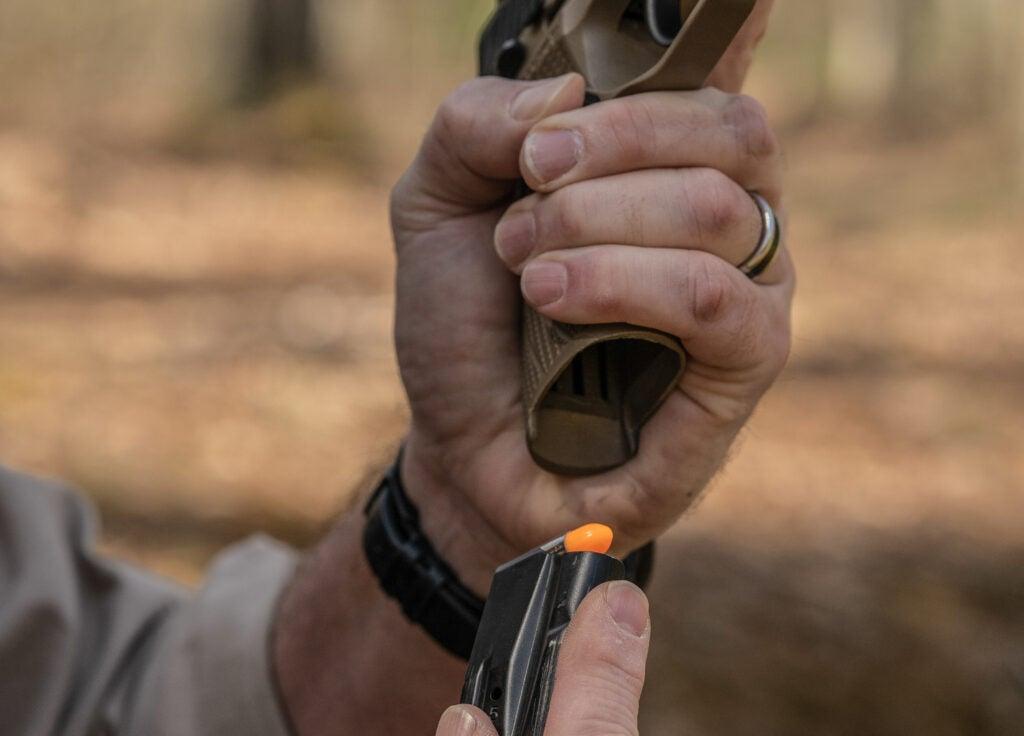 The author reloads a handgun