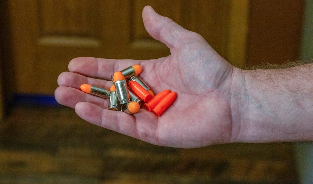 Handgun dummy rounds.