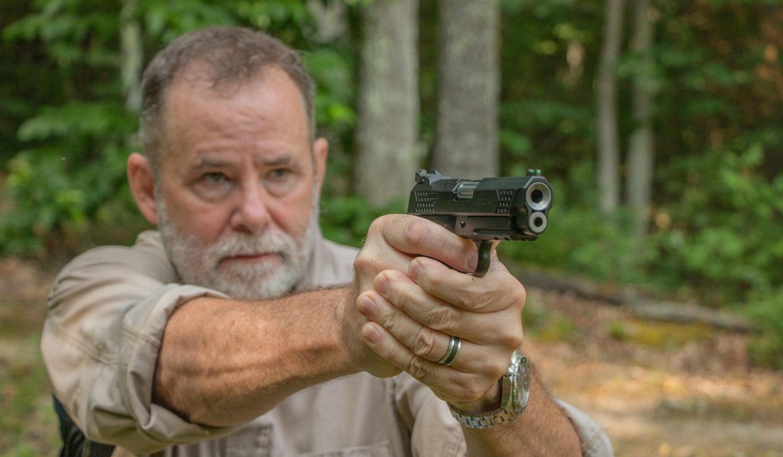 Richard Mann shoots a handgun