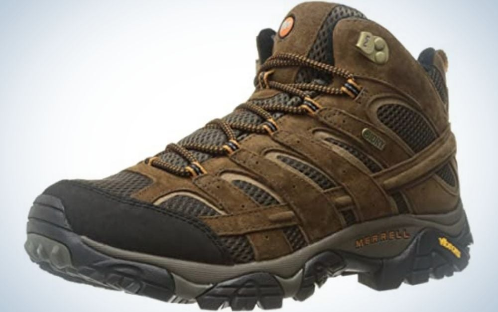 A thick and brown men's winter shoes with thick laces and a dark rubber with the Merrell logo on it.