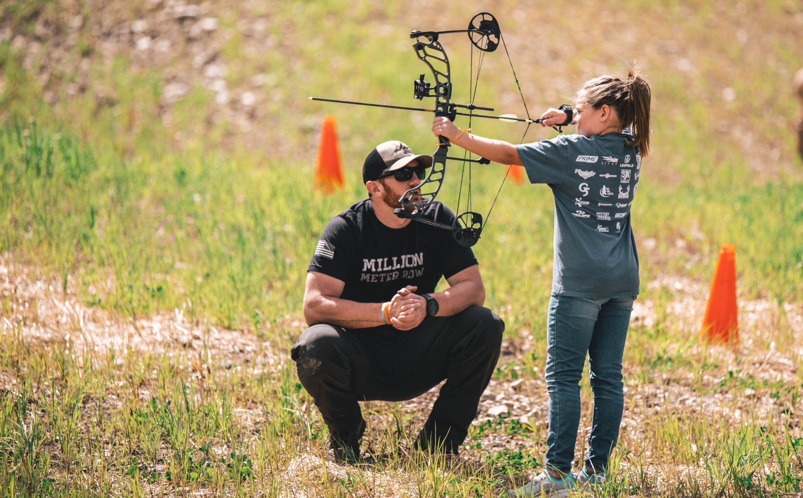 Young girl shoot a Quest Centec bow