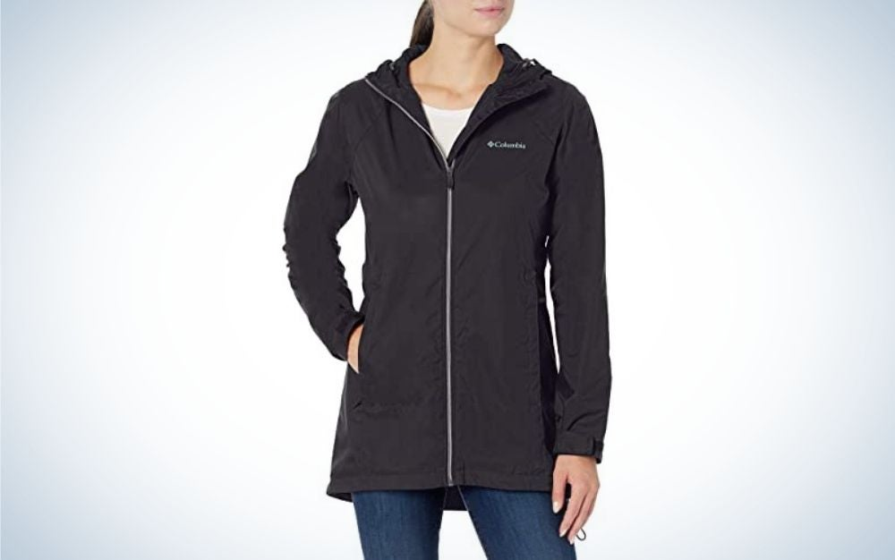 A girl wearing a black windbreakers jacket with a white zipper.