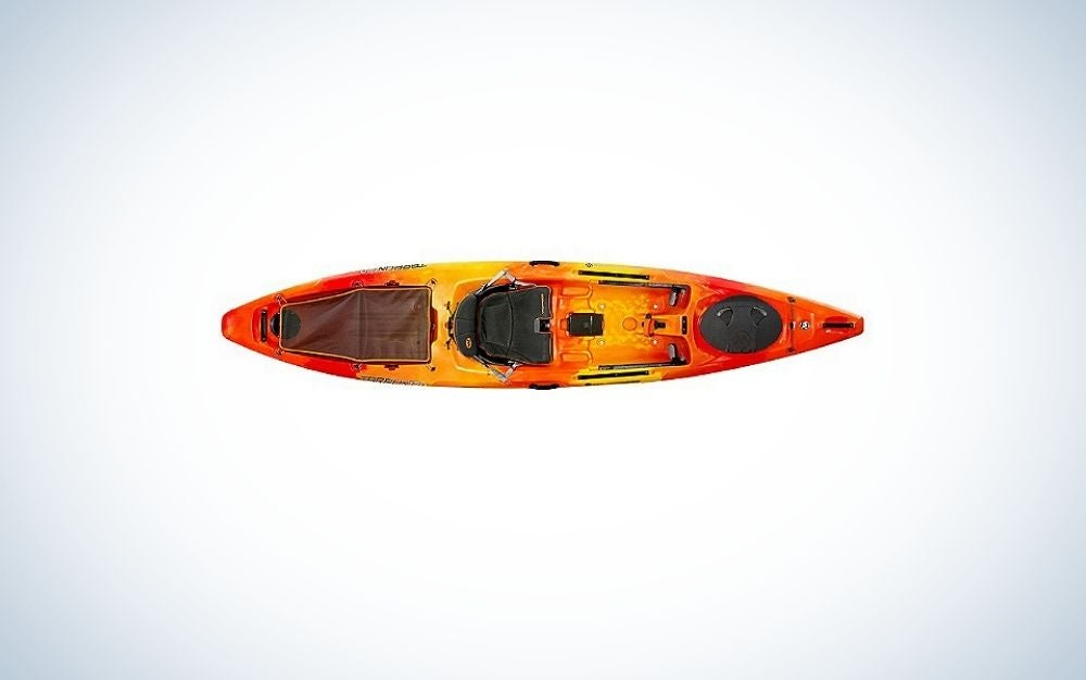 A kayak in an orange in the body and black on the place where you can sit.