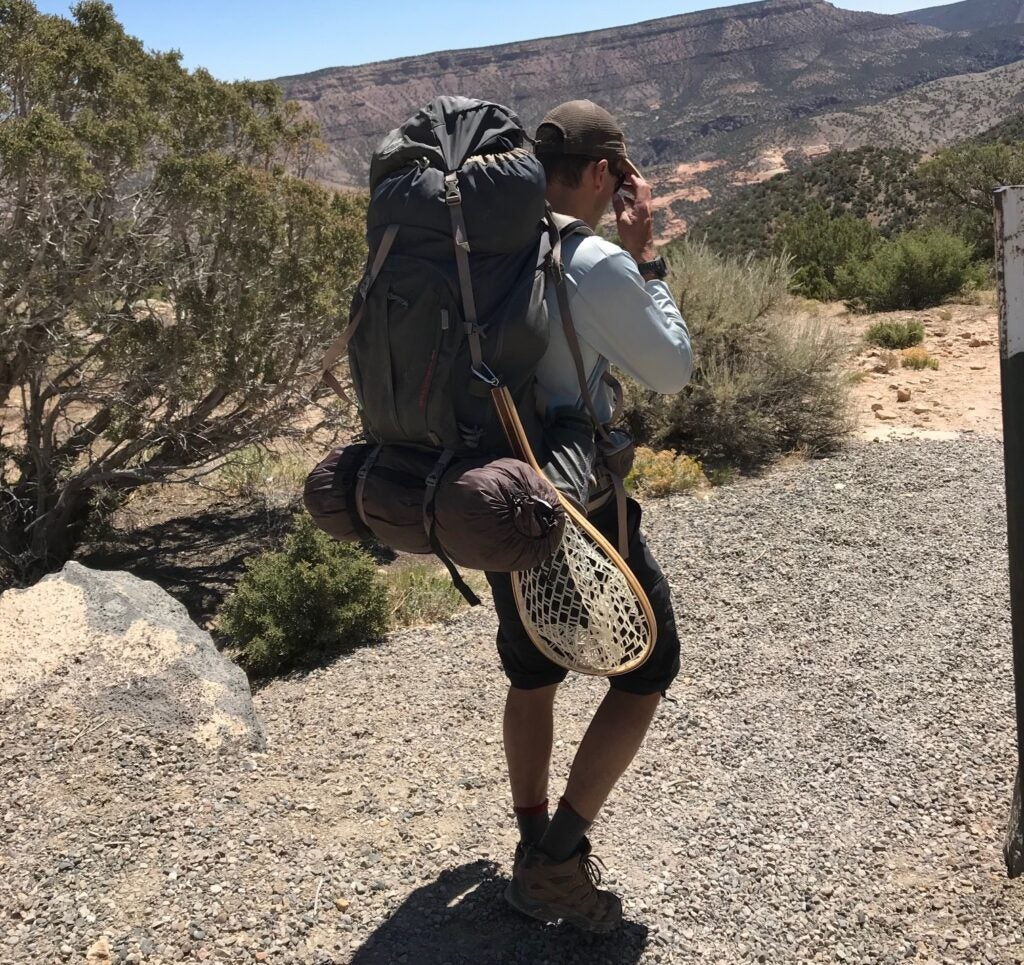 fisherman hiking with a backpack.