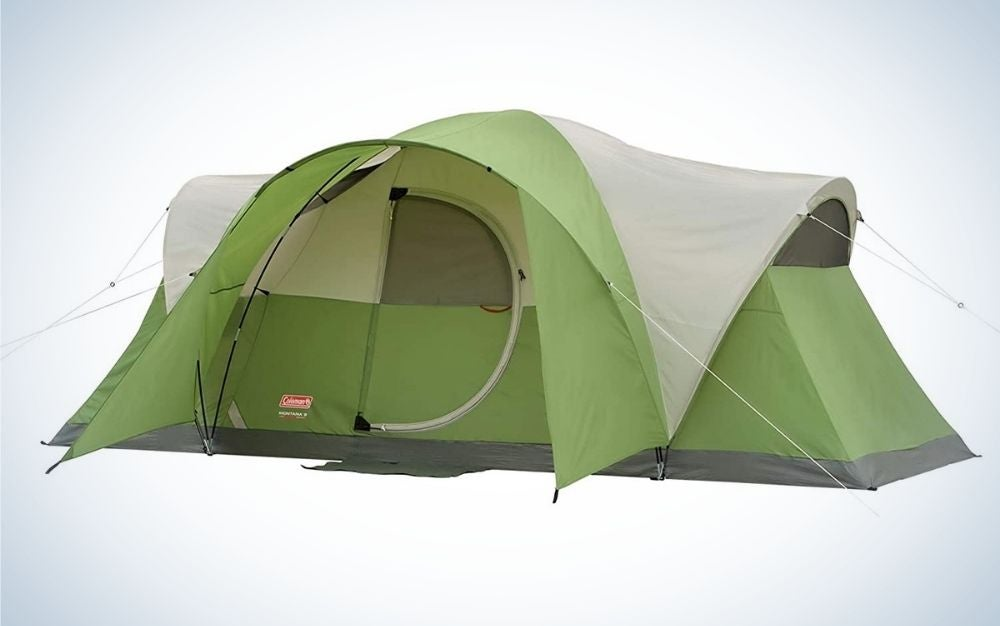 A large solid green and light green tent with an entrance and a translucent piece in the position of a window and with side ropes.