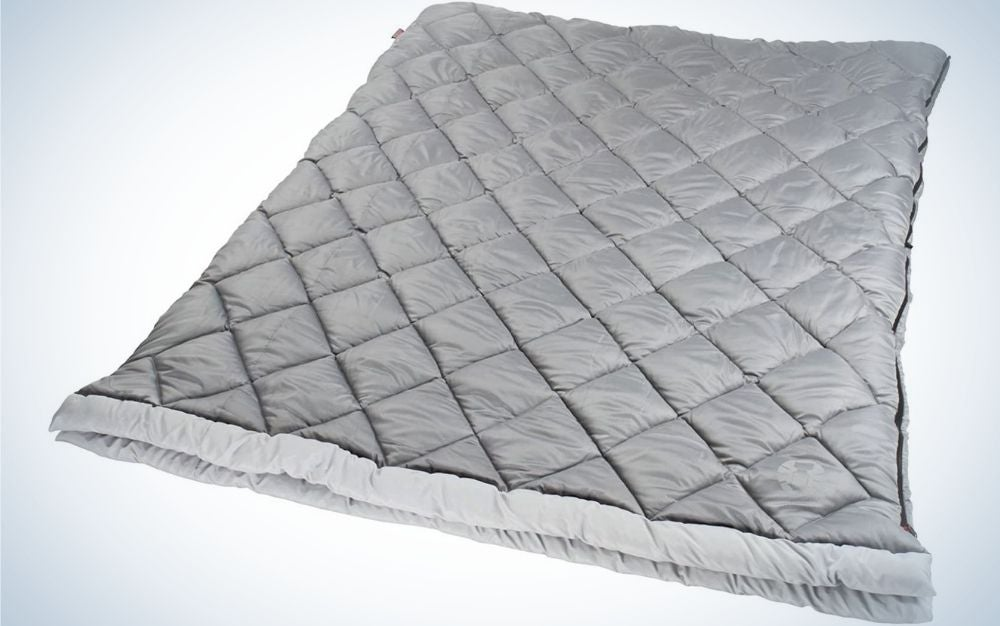 A large double sleeping bag in a grey color for the adults.
