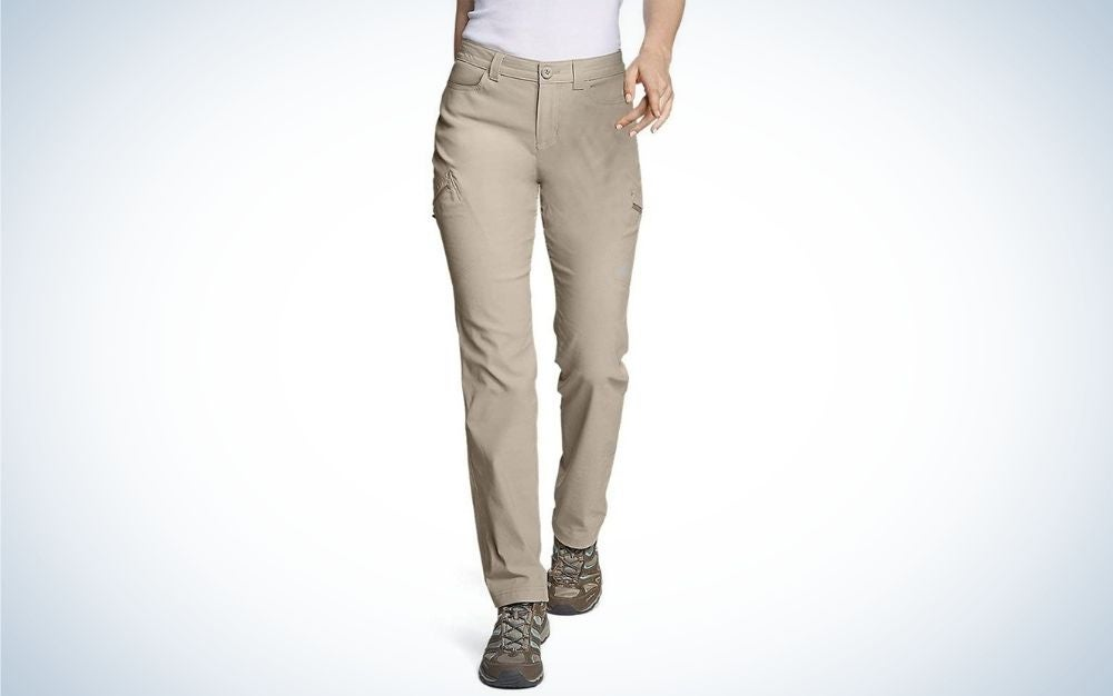 A pair of tight beige hiking pants with a pocket on the side.