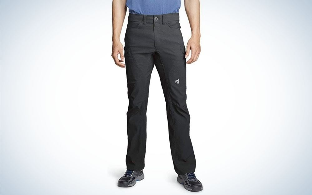 A man wearing trousers with pockets for hiking and blue.