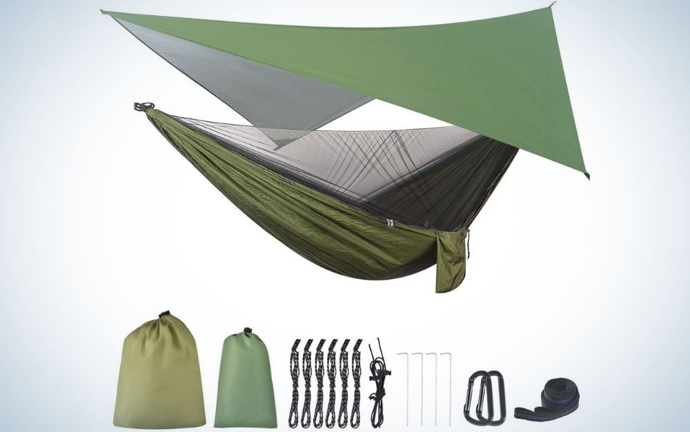 A green hammock with a cover blanket also in green color and two bags for placing the folded hammock, rope and two metal steel carabiner.