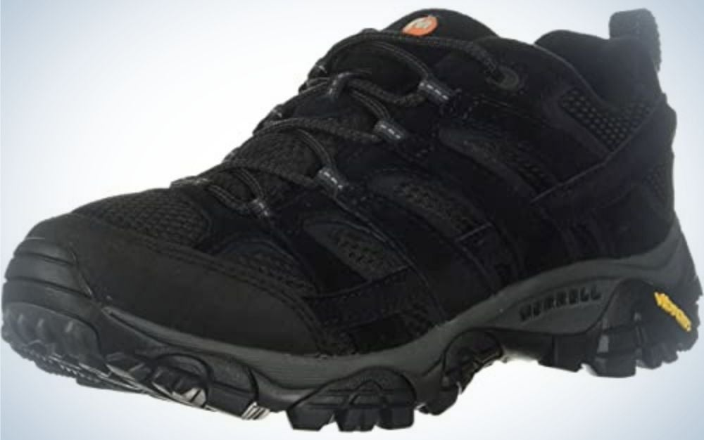 A thick winter shoe with high rubber and strong and thick laces all dark gray color of a neon yellow stripe from the back.